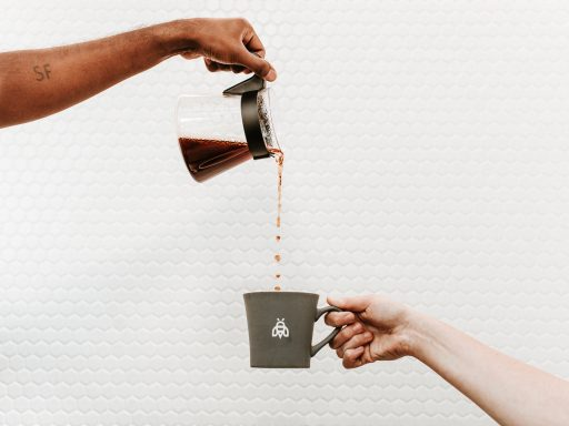 Pouring a fresh cup of coffee at Industrious Bellevue, outside Seattle. (Aspen Jeanné Photography)