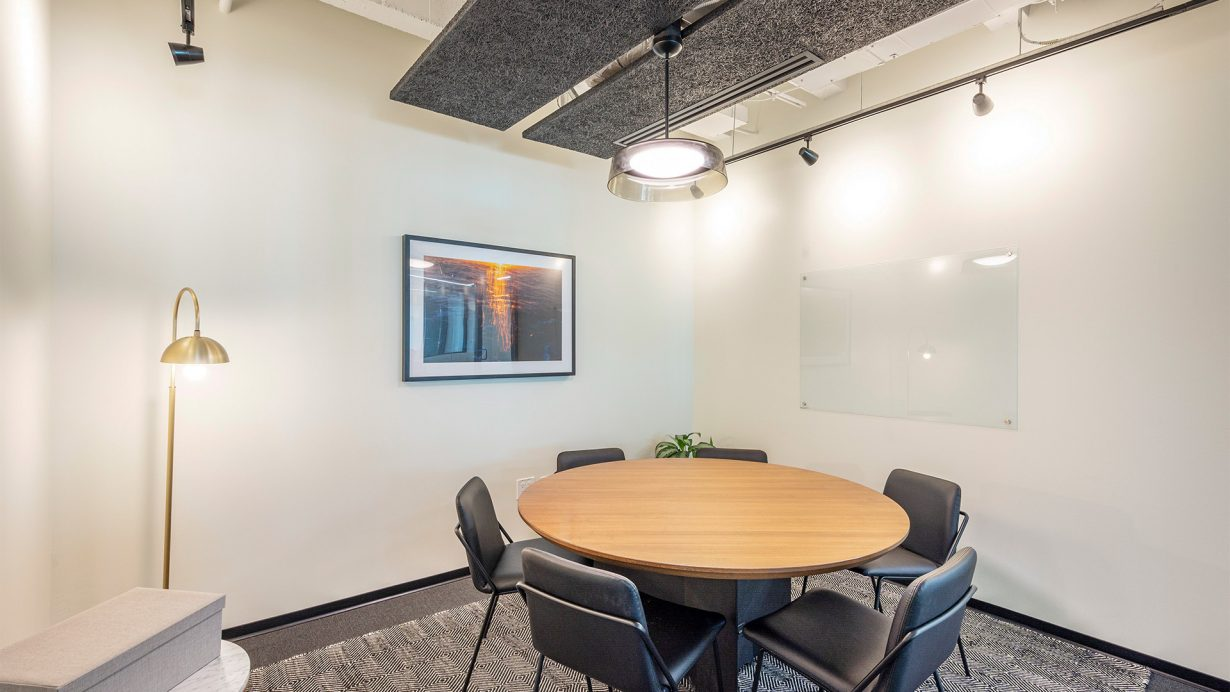 This meeting room is just the right size for a small team huddle.
