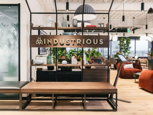 A warm and inviting reception area greets members and visitors at Seattle's Industrious Bellevue.