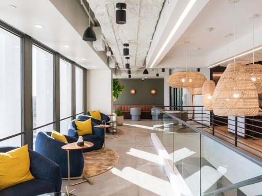 Floor-to-ceiling windows fill the common areas and private offices of Industrious Pasarroyo with soft, natural light.