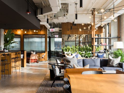 Sleek wood furnishings and plenty of greenery create an inviting atmosphere in Chicago's Industrious Fulton Market.