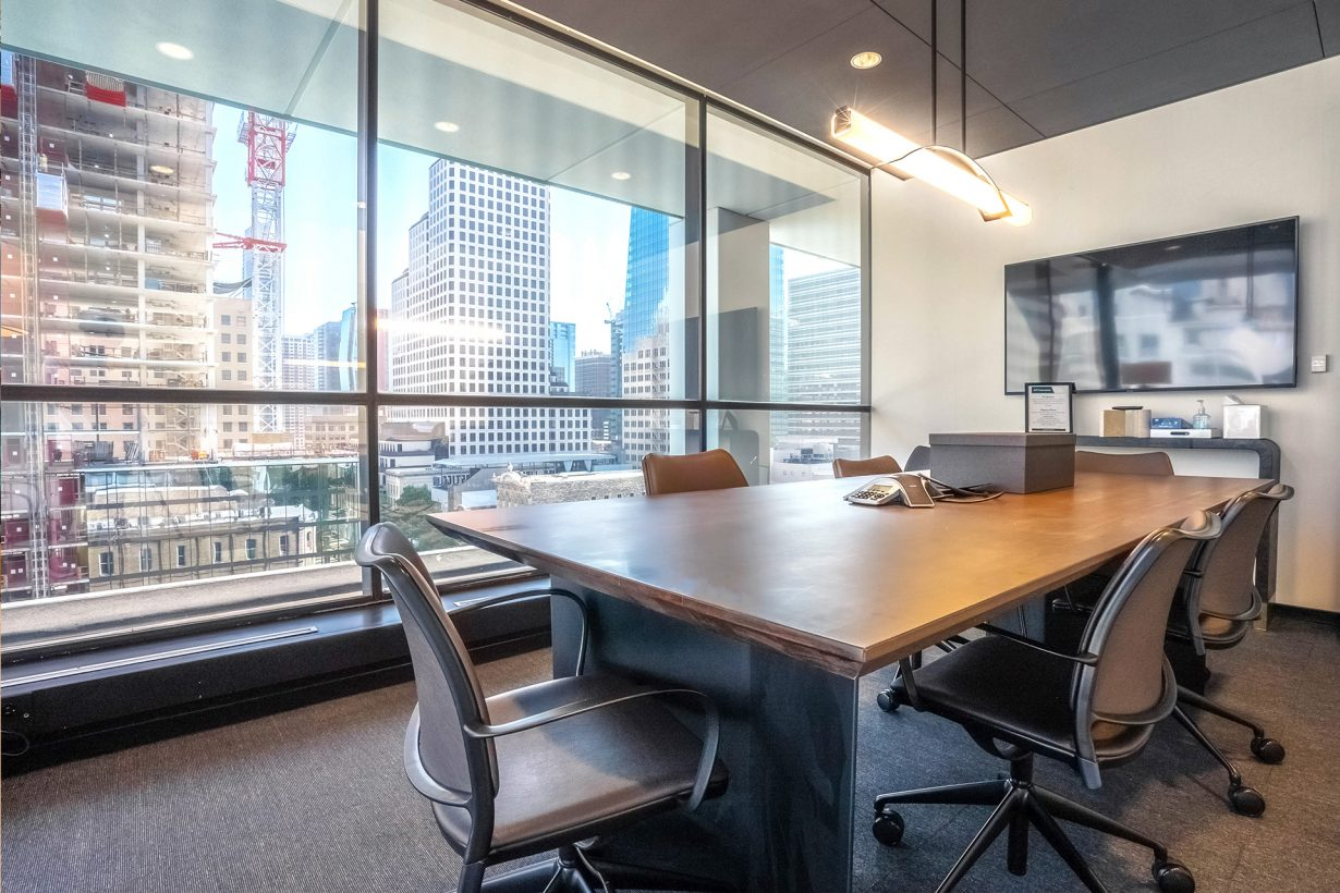 A conference room equipped with A/V for presentations and mixed-presence meetings.