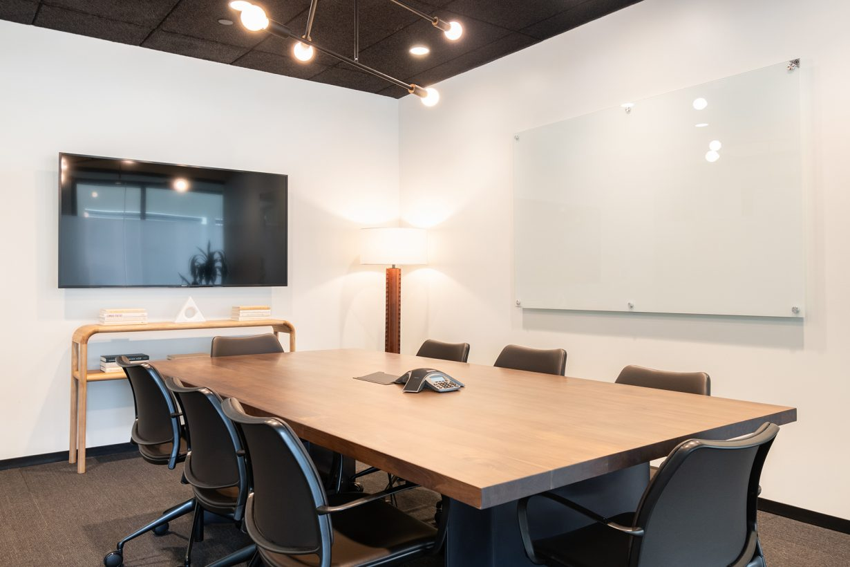 Members can book conference rooms like this one, which come equipped for presentations or video calls.